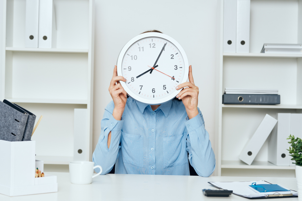 Business,Woman,Watches,At,The,Desk,Documents,Professional